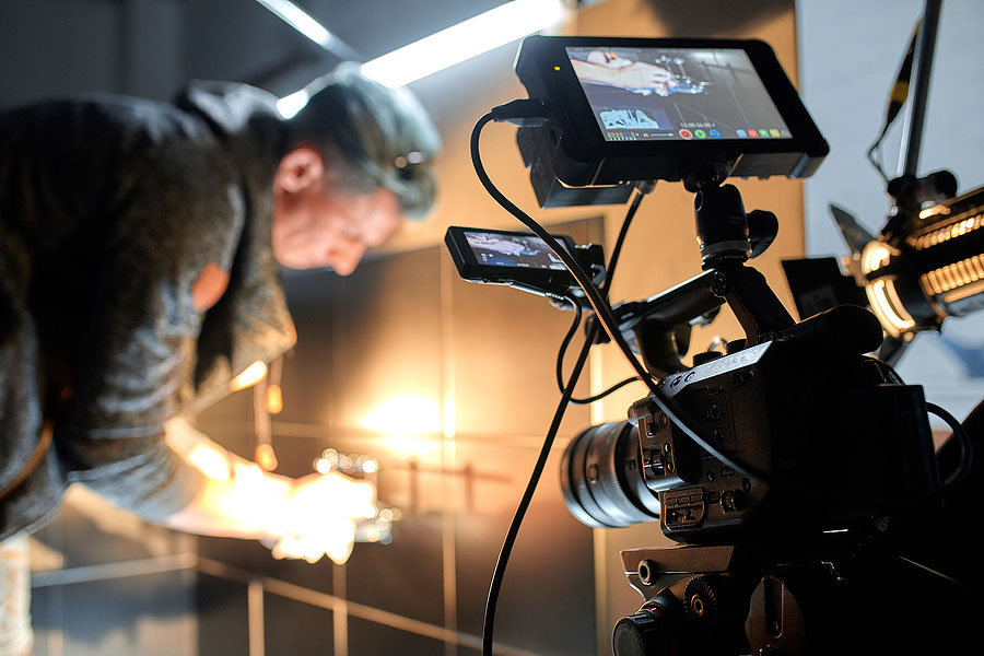 A picture of a man working on shooting some product photography