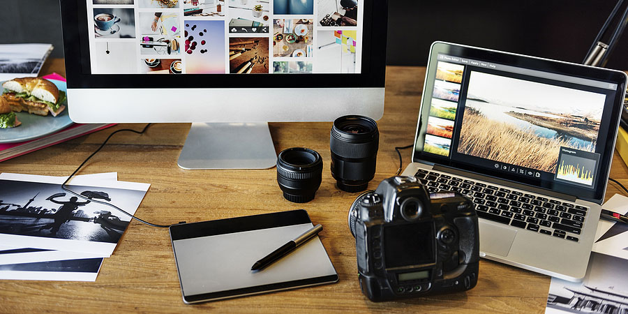 A desk covered in photography and editing gear
